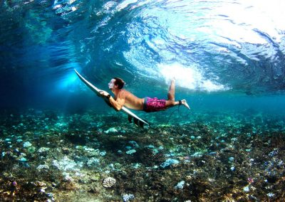 Max Gouchen duckdiving trough crystal clear indonesian water